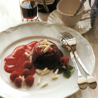 Warm Chocolate Tortes with Raspberry Sauce