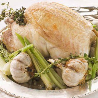 Roast Chicken Stuffed with Bread and Garlic