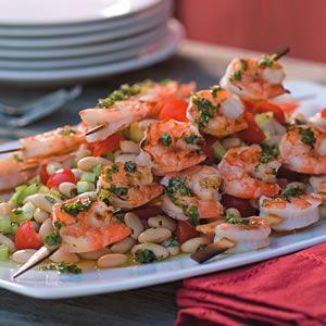 Grilled Shrimp Skewers over White Bean Salad