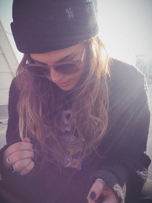 peaceful on the roof in her creep co. beanie and fall friend sweater.
