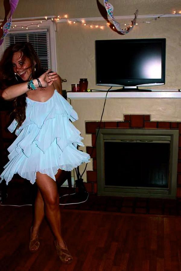 dancing in Cascades Of Ruffles Tunic