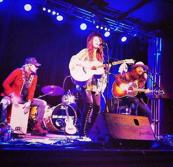 On stage last night in nashville rocking my free people boots!